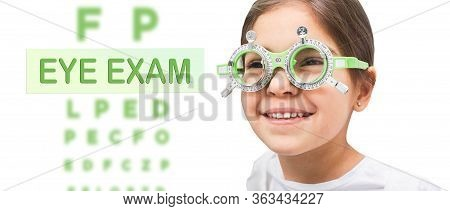 Child Eye Test And Eye Exam. Little Girl Having Eye Check-up, Wearing Special Glasses. Vision Diagno