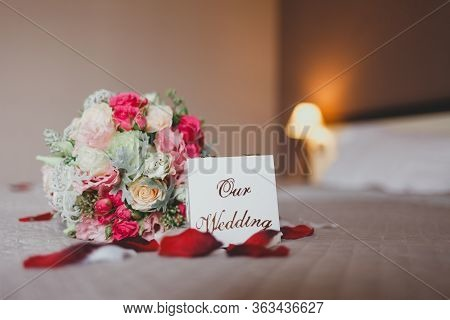 Romantic Surprise In The Form Of Wedding Rings On The Bed Of A Hotel Room. Box With Wedding Rings On