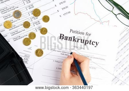 Filling Petition For Bankruptcy, Wallet With Coins, Documents And Glasses. Bankruptcy Concept.