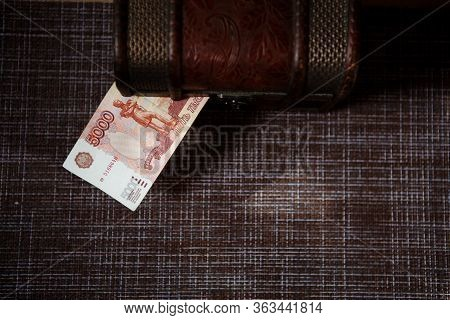 Russian Banknotes 1000, 2000, 5000 Rubles Are In The Trunk. Financial Concept Of Household Finances