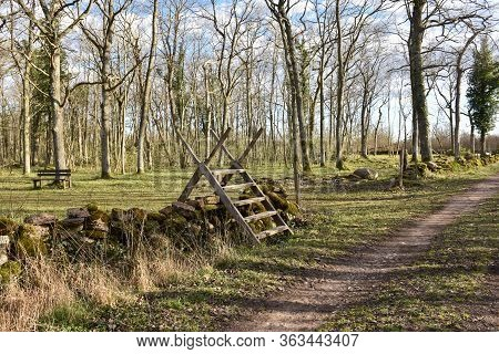 Wooden Stile By A Country Road In The Swedish Nature Reserve Karum On The Island Oland