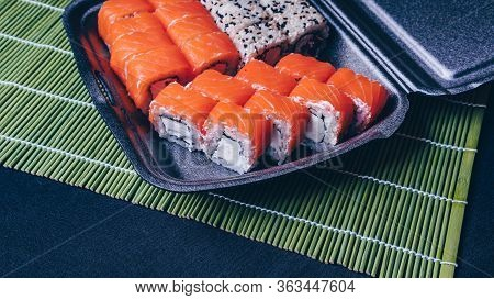 Sushi Rolls Mix In A Plastic Box Container, Set Of Delicious Sushi Rolls. Japanese Food. Sushi Menu.