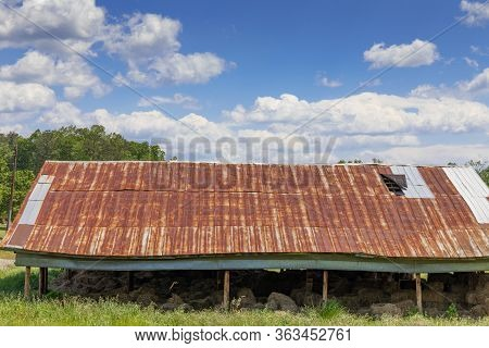 Open Side Pole Barn With Hay Bales, Rusted Tin Roof, Creative Copy Space, Rural Farm Pasture, Horizo