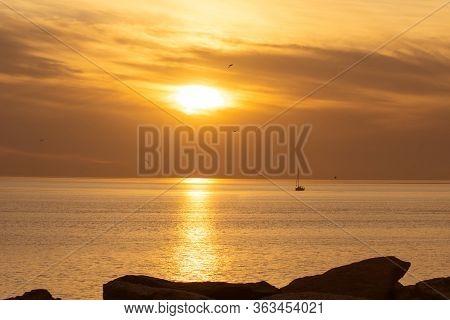 Amazing Landscape Of Orange Sunset Near The Sea