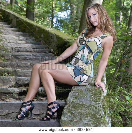 Beautiful Young Woman Posing On Old Steps