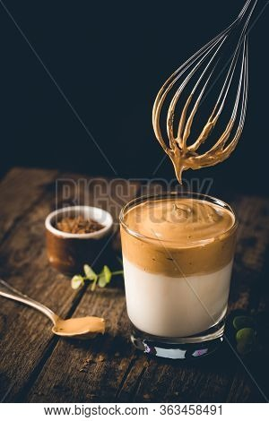 Dalgona Coffee, A Cool Fluffy Whipped Coffee In A Glass. Latte Espresso With Coffee Foam In Tall Gla