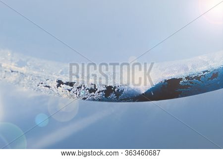 Travel Concept. Frosty Aircraft Illuminator Window With Hole Illuminated By Sun Beams And Lens Flare