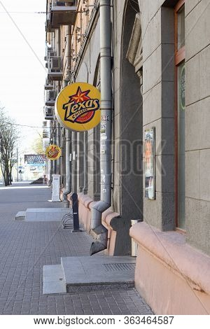 Minsk, Belarus - April 27, 2020: A Sign Of The Texas Chicken Restaurant In Front Of The Entrance. Il