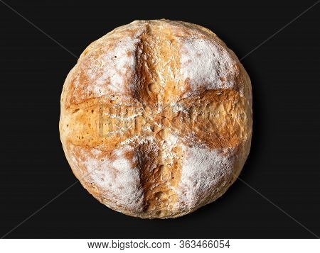 Homebaked Bread. Top View Round Peasant Bread Isolated On A Black Background. Homemade Baking.