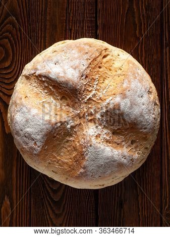 Homebaked Bread. Top View Of Wheat Bread On A Wooden Background. Homemade Baking.