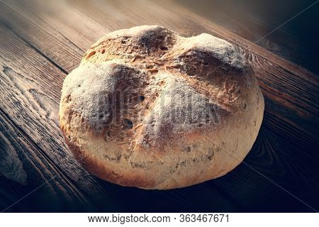 Homebaked Bread. Wheat Hot Bread On A Wooden Background. Homemade Baking. Toned Image.