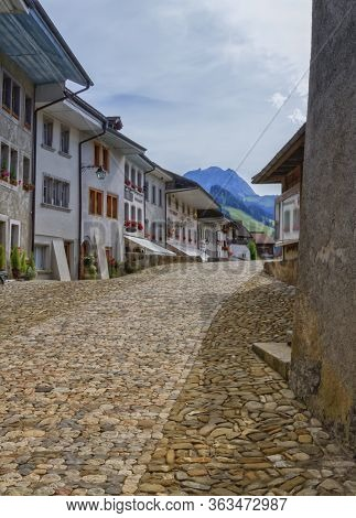 Street In Gruyere Village In Fribourg Canton By Beautiful Day, Switzerland