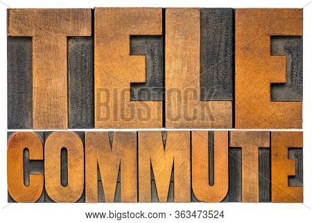 telecommute - isolated word abstract in vintage letterpress wood type,  telecommuting, telework, teleworking, working from home (WFH), mobile work, remote work, and flexible workplace concept