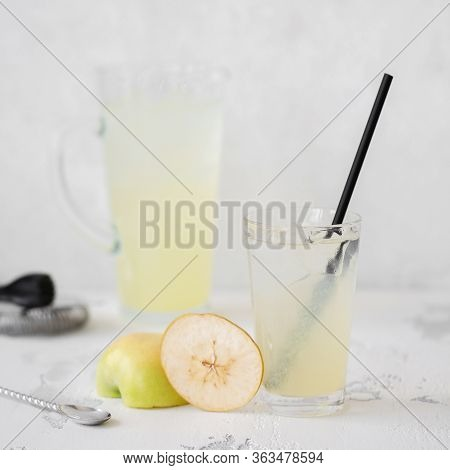 Summer Refreshing Cocktail With Apple And Lemon. Refreshing Drink In A Glass On A Light Stone Backgr