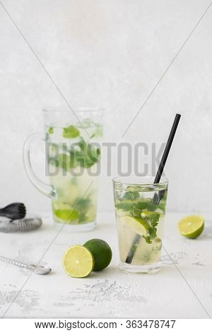 Classic Mojito Cocktail In A Glass. In The Background Is The Decanter And The Bartenders Instruments