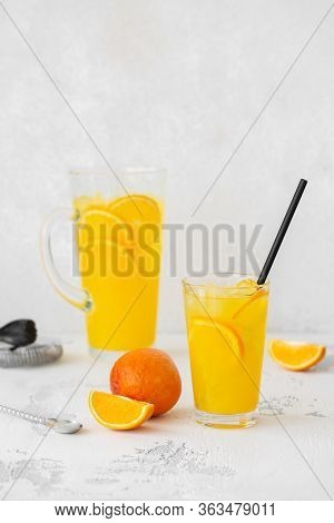 Summer Refreshing Cocktail With Orange. Refreshing Drink In A Glass On A Light Stone Background With