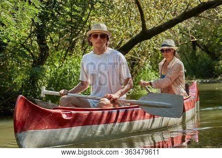 Canoeing in narrow wild passages on Lake Tisza