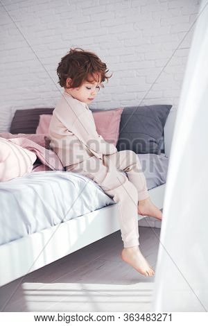 Cute Redhead Baby Boy Getting Up In The Morning At Sunny Bedroom