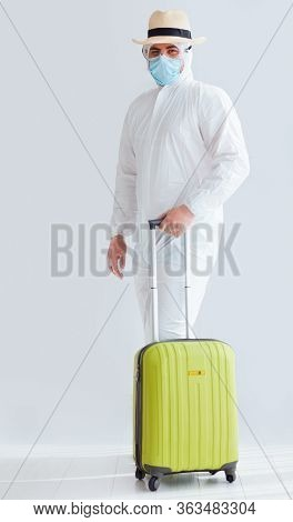 Man, Tourist Equipped In The Protective Medical Suit Ready To Travel On Holiday Vacation, Coronaviru