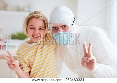 Father In Protective Medical Suit Having Fun, Hugging With Infected, Contagious Boy, Visiting Hospit