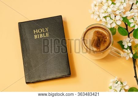 The Bible And Cup Coffee With Spring Flowers On A Color Background. Concept For Faith, Spirituality