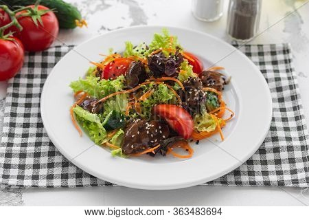 Salad Of Fresh Vegetables, Chicken Liver And Korean Carrots. Dressed With Sauce And Sprinkled With S