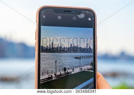 New York, Usa. May 10, 2019. Girl Taking Photo Of Manhattan View From The Domino Park Sign In Willia