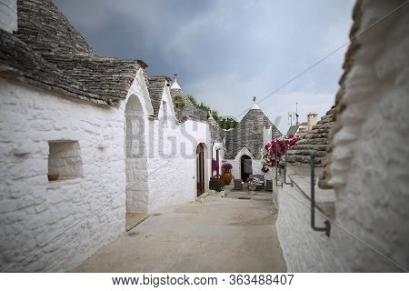 The Beautiful White Yards With A Special Houses Of Alberobello In The Southern Part Of Italy Near Ba