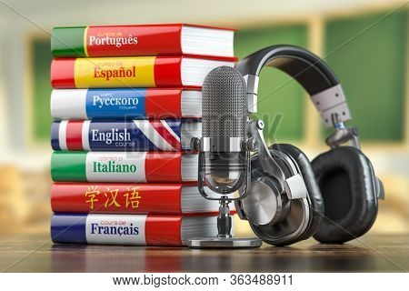 Learning languages online.  Dictionary books of different languages with headphones and microphone. 3d illustration