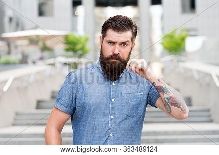 Bearded Man. Confident Brutal Man Walk Street. Male Barber Care. Male Fashion. Guy With Beard And Mu