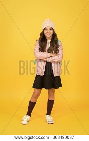 Add Touch Of Warmth To School Uniform. Happy Girl Yellow Background. Adorable Girl Child Back To Sch