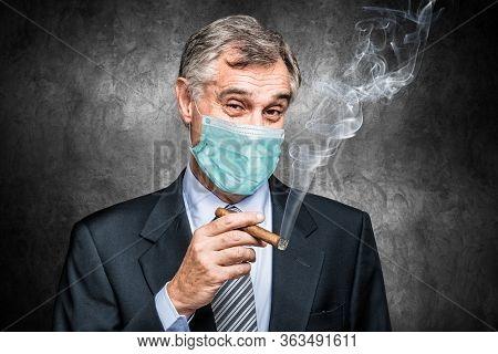 Masked businessman smoking a cigar, success concept during corinavirus pandemic