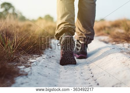 Hiking Shoes Woman In Beautiful Road Trail,hiker Trekking Or Walking At Nature,close Up