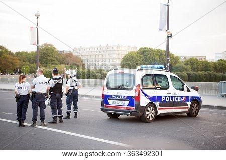 Paris, France - September 29, 2017: Police Car Block Road. Traffic Police Officers. Patrol Vehicle.