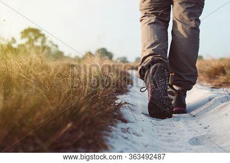 Trekking Shoes Woman In Beautiful Road Trail,hiker Trekking Or Walking At Nature,close Up
