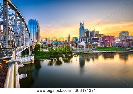 Nashville, Tennessee, USA downtown city skyline at dusk on the Cumberland River.