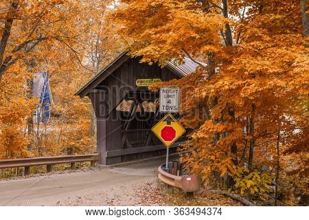 Stowe, Vermont, USA at Emily's Bridge with fall colors.