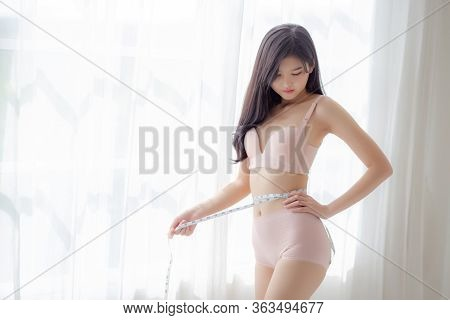 Beautiful Young Asian Woman Sexy Body Slim Measuring Abdomen For Control Weight Loss In The Room, Be