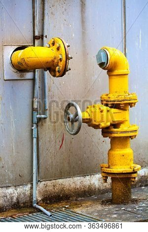 Bright yellow pipes in street