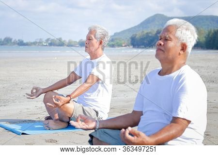 Two Elderly Men Exercise At The Beach By The Sea In The Morning Have A Happy Life After Retirement.