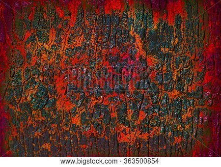 Cracked volcanic texture activated charcoal with red lava or magma for background.