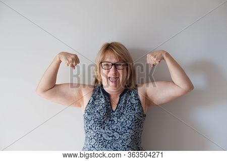 Funny Older Person Happy Thick Fat Woman In Glasses Showing Muscles Indoors Self Isolation Quarantin