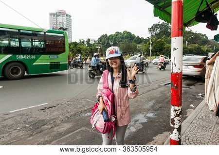 Saigon Vietnam - October 12 2013; Young Vietnamese Woman In Trendy Cap And Clothes Smiles And Wave O