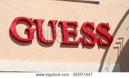 Palma de Mallorca, Spain - September 23, 2017: Guess store sign. Guess is an American clothing brand and retailer.
