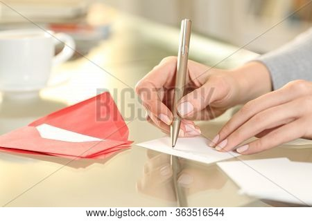 Close Up Of Woman Hand Writing Greeting Thank You Card Sitting On A Desk At Home