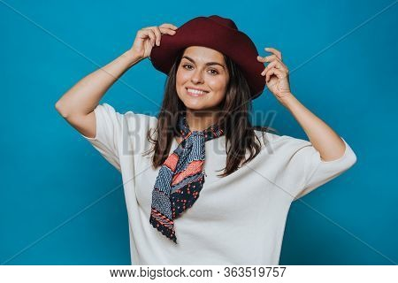 Attractive Young Lady Holds Her Hat, Looking In Love, Dressed In White Sweater, Burgundy Hat With A