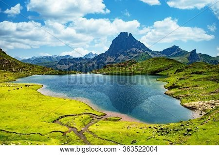 View Of The Pic Du Midi D'ossau With Lake In The French Pyrenees