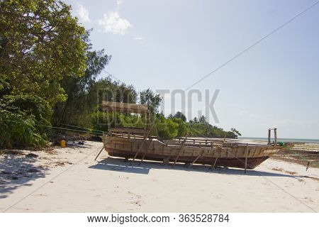 Boat On A White Sand Beach On A Sunny Day