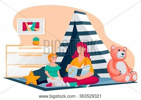 Happy Mother And Daughter Reading Fairytale Book Together. Mom And Little Girl Sitting In Hut In Pla