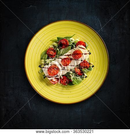 Delicious Caprese Salad With Ripe Tomatoes And Mozzarella Cheese, Flat Lay Shot, Dark Background